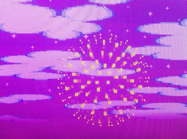 Yellow firework on a purple sky