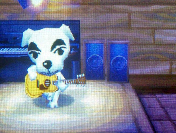 KK Slider singing through a grin