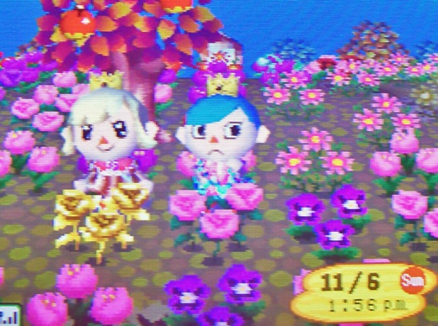Kammile and I matching the pastel garden with our pastel dresses and crowns