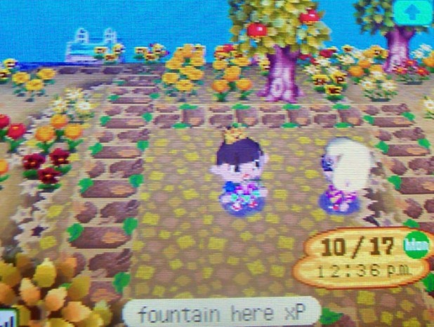 Showing Kammile where I plan to put a fountain on my island