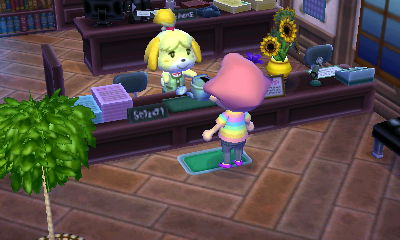 Isabelle giving the watering can